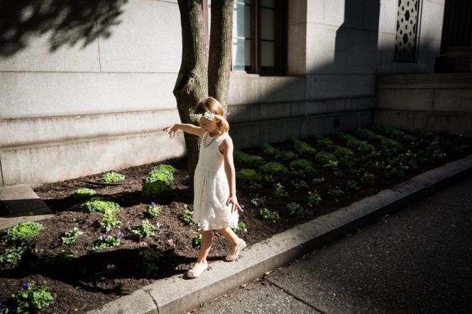 Flower girl walking on curb for an article on How to Get Married at City Hall in Any NYC Borough