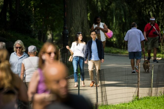 Couple walking in park for an article on a Central Park lake proposal