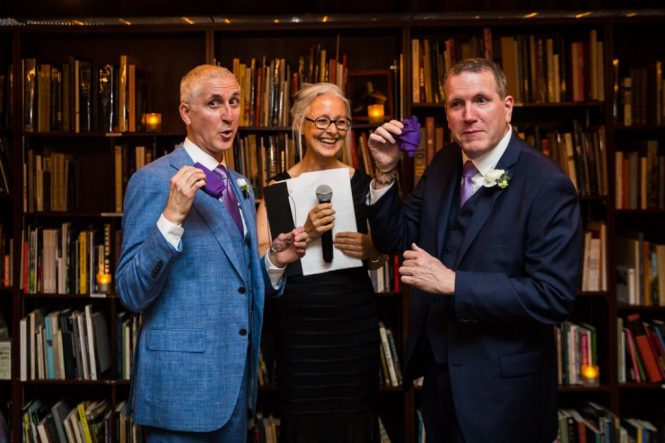 Two grooms with handkerchiefs at a Housing Works Bookstore Cafe wedding