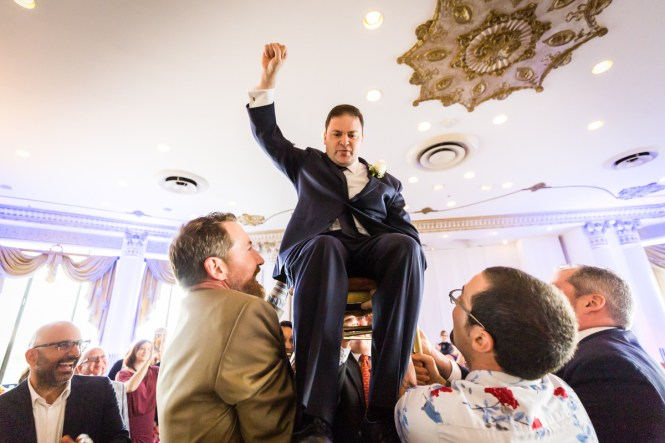 Groom dancing the hora for article on a Terrace on the Park wedding