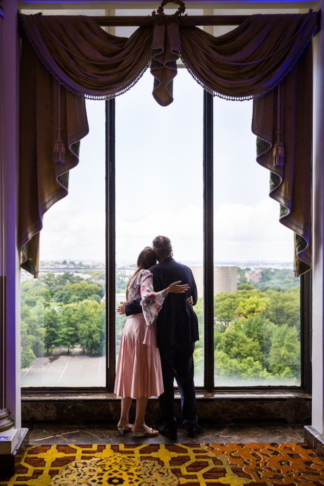 Guests looking out window for article on a Terrace on the Park wedding