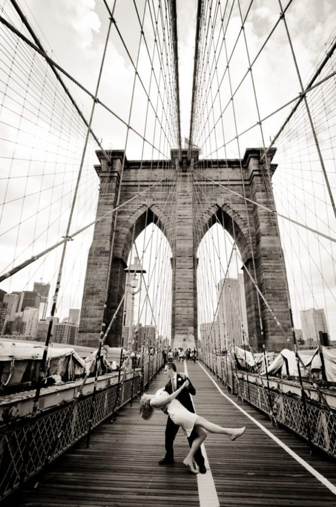 Couple on Brooklyn Bridge for an article on City Hall wedding portrait locations