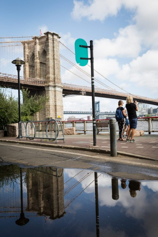 Tourists and Brooklyn Bridge for an article on City Hall wedding portrait locations