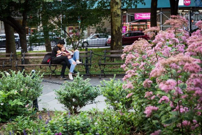 Couple on a bench for an article on City Hall wedding portrait locations