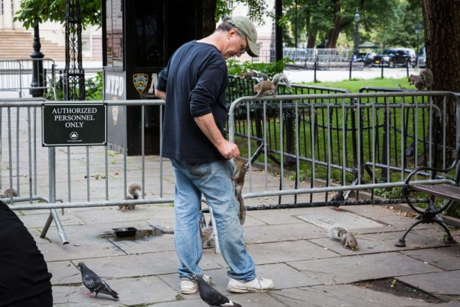 Man with squirrels for an article on City Hall wedding portrait locations
