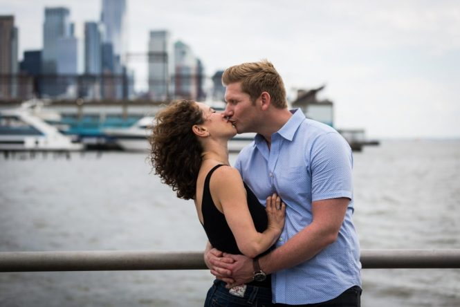 Kissing couple in a Hudson River Park Family Portrait