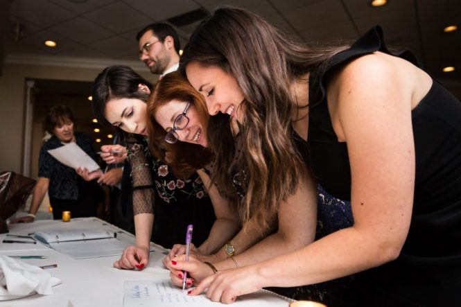Guests filling out cards at a Larchmont Shore Club wedding