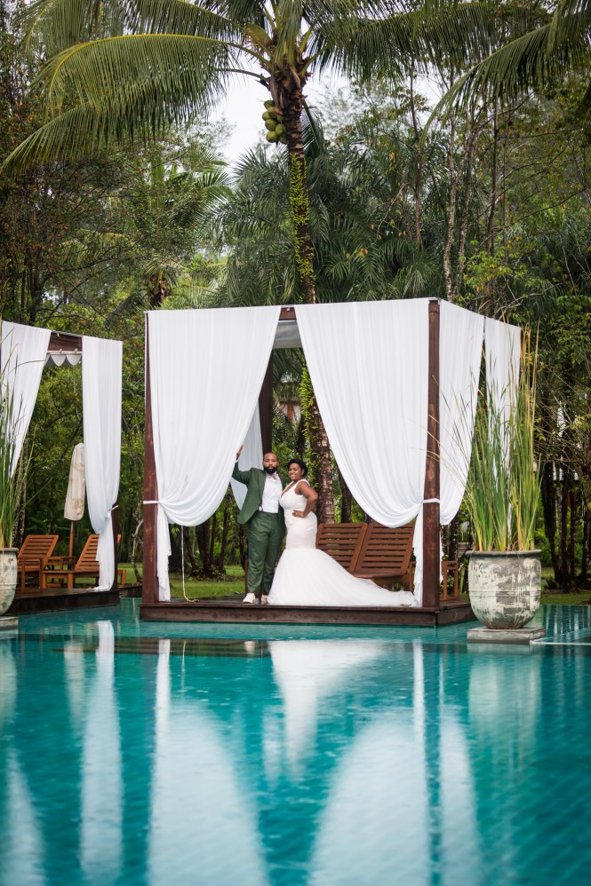 Bride and groom at a pool for an article on destination wedding photography tips