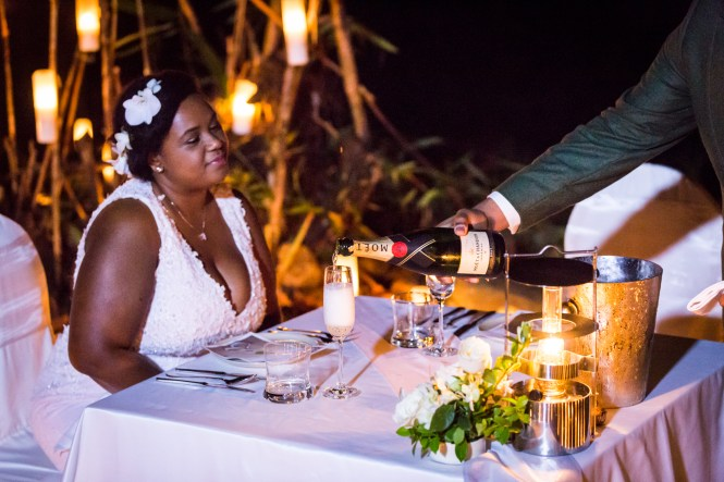 Bride being served champagne for an article on destination wedding photography tips