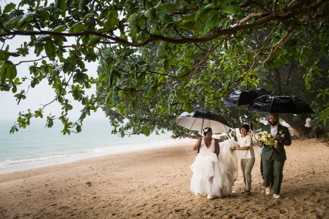 Bride and groom on a Thailand beach for an article on destination wedding planning tips