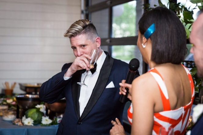 Groom crying at toast at a same sex wedding celebration in Washington DC