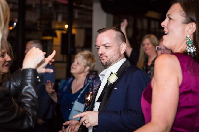 Groom dancing at a same sex wedding celebration in Washington DC