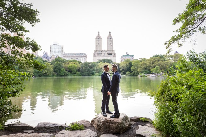 Two grooms in front of Central Park lake for an article entitled, 'Do you need a permit to get married in Central Park?'