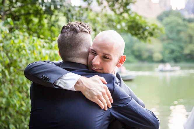 Guest hugging groom for an article entitled, 'Do you need a permit to get married in Central Park?'