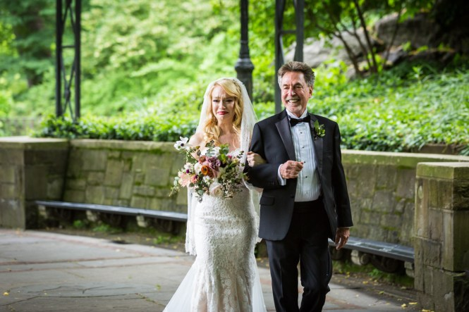 Bride and father walking down aisle at a Central Park Conservatory Garden wedding