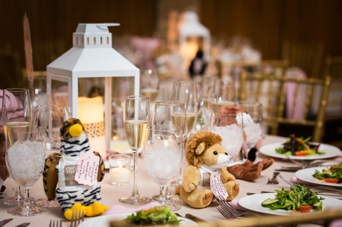 Table setting with stuffed animals for an article on non-floral centerpiece ideas