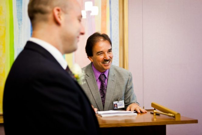The officiant at a NYC City Hall wedding, by Kelly Williams