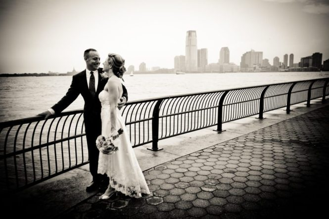 Bride and groom portrait in Battery Park after a NYC City Hall wedding, by Kelly Williams