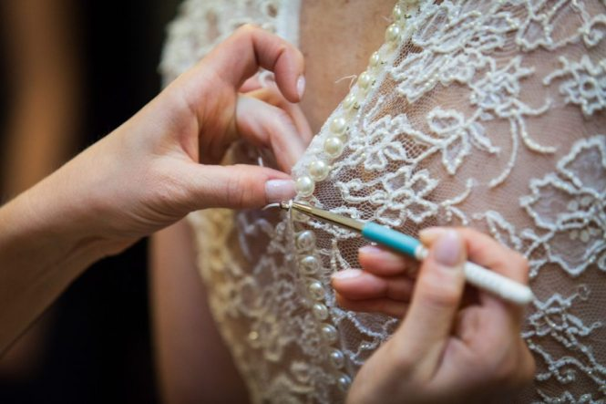 Crochet hook in use for the wedding dress by photographer Kelly Williams