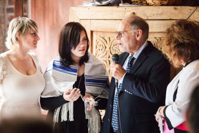 Grandparents making a toast, by NYC bat mitzvah photographer, Kelly Williams