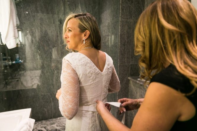 The bride getting ready before a Housing Works Bookstore wedding, by NYC wedding photojournalist, Kelly Williams
