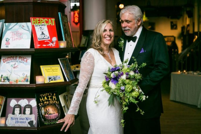 Portrait of the bride and groom at a Housing Works Bookstore wedding, by NYC wedding photojournalist, Kelly Williams