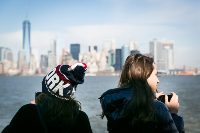 Tourists on the Staten Island Ferry, by NYC photographer, Kelly Williams
