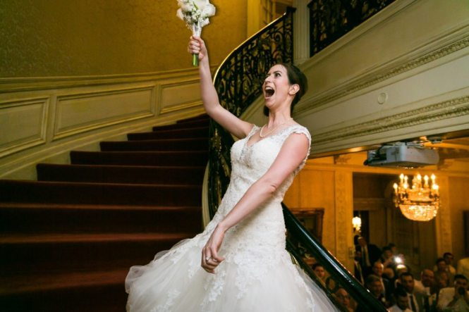 Bouquet toss at a Columbus Citizens Foundation wedding by NYC wedding photojournalist, Kelly Williams
