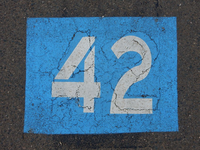 The number 42 in white text on a blue solid background