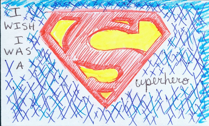 "What appears to be a child's drawing of the ""Superman S"" and the words ""I wish I was a Superhero."""