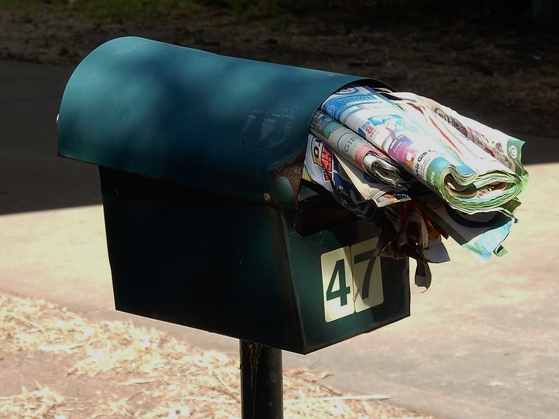 A physical mailbox overflowing