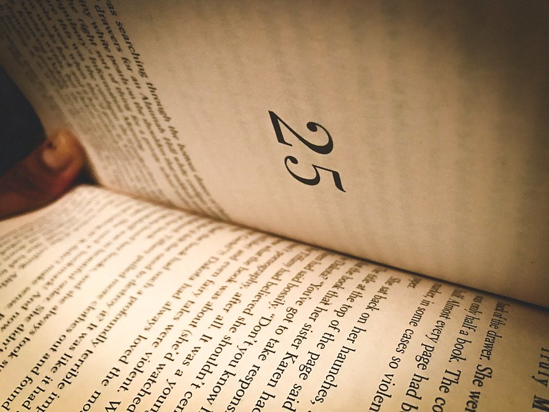 A book partially open from the side with a clear view of the chapter number: 25