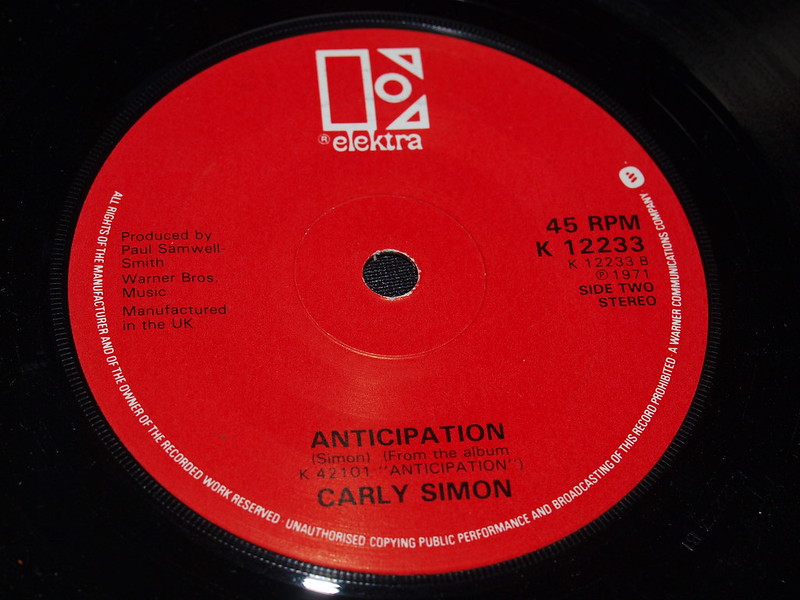 """Close shot of the label of """"Anticipation"""" single (45 rpm) by Carly Simon."""