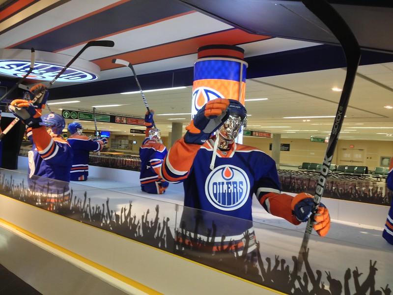 Edmonton Oilers baggage claim at YEG> Manequins dressed in Oilers gear at the baggage claim.