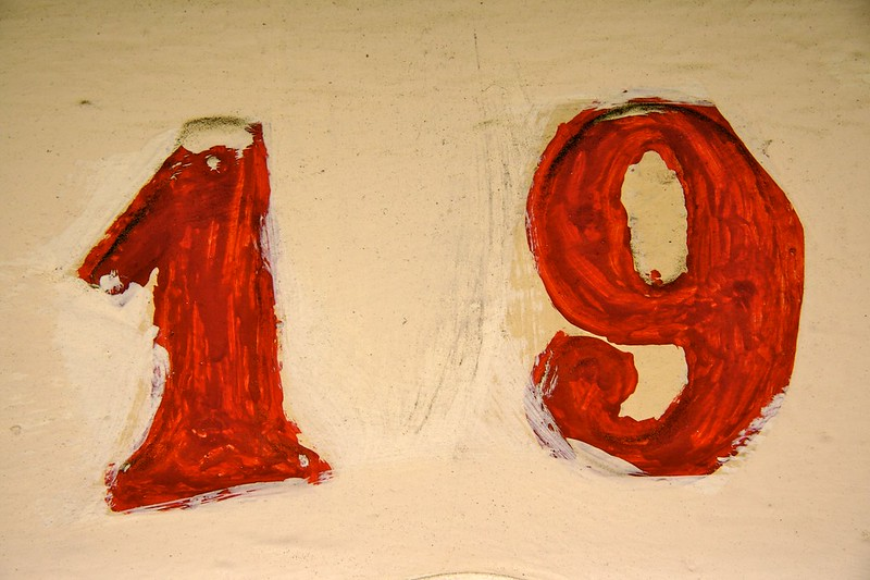 Nineteen in red painted numbers.