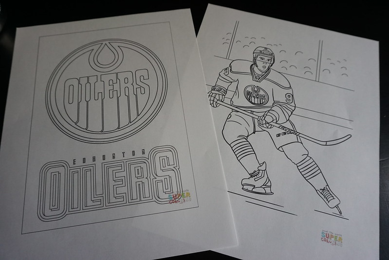 Two sheets from an Edmonton Oilers coloring book, logo of the Oilers and Connor McDavid.