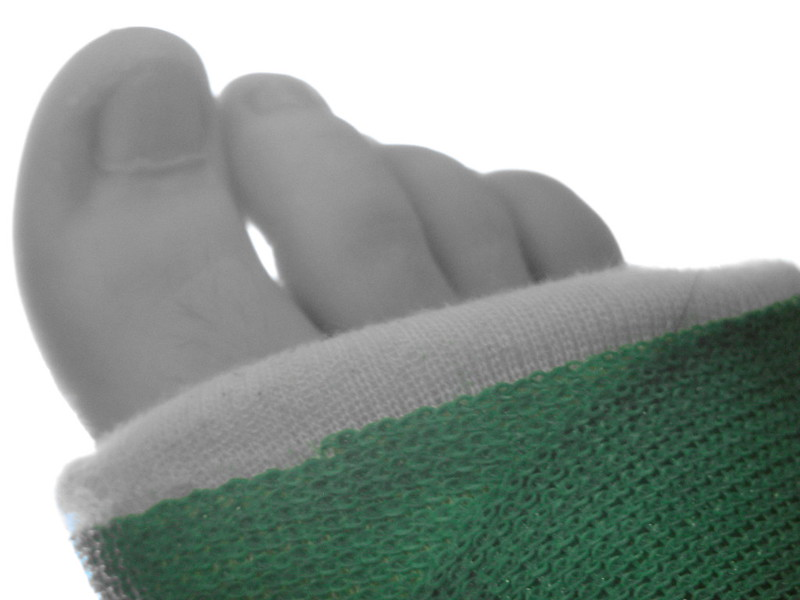 Upclose of toes in a cast, just green showing through on camera.