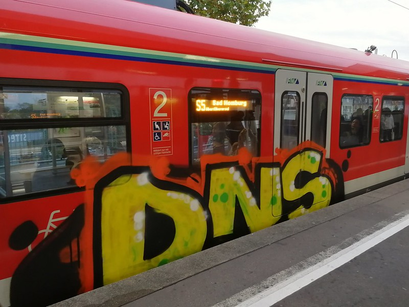 Train car in Germany with DNS painted in graffiti on the side.