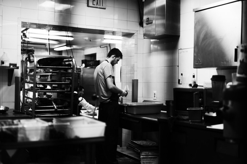 A cook reparing food in the back of a Philadelphia restaurant.