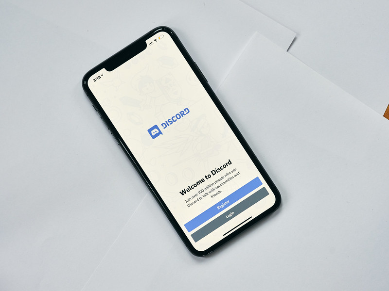 View of the opening screen (with buttons for Register and Login) of the Discord app on an iPhone.