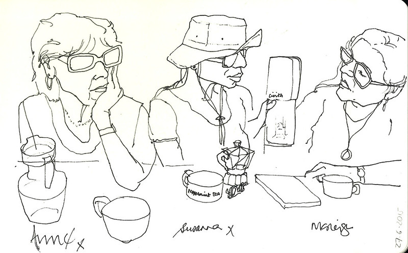 Sketch art of what appears to be three women drinking coffee and showing wallet photos.