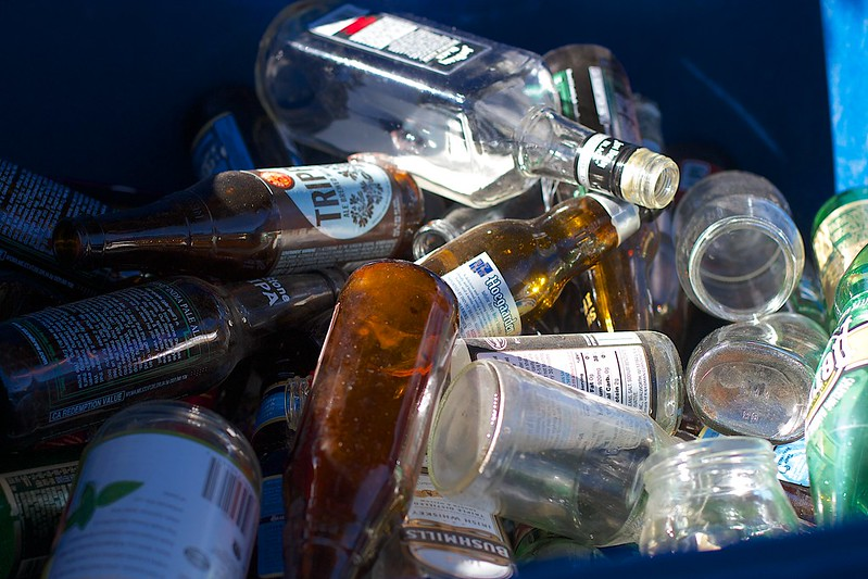 A bin of various bottles and cans ready to take to the recycling depot.