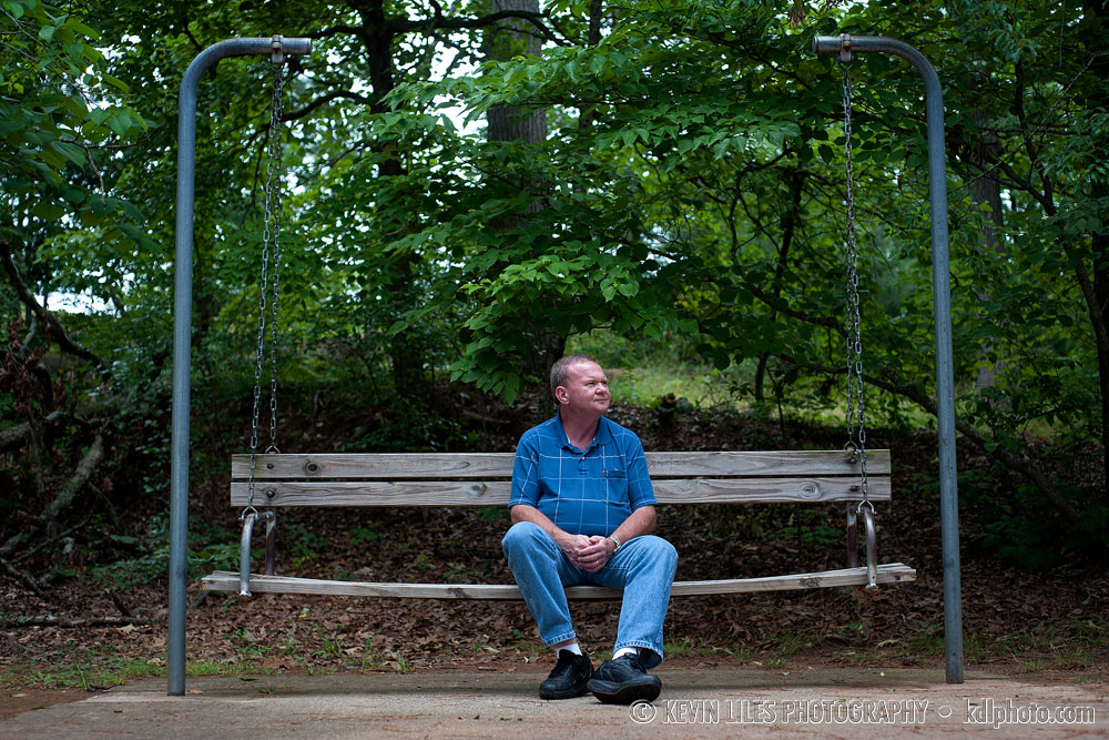 June 5, 2012; Randal Liles sits on a bench at Buford Dam. Photo by Kevin Liles