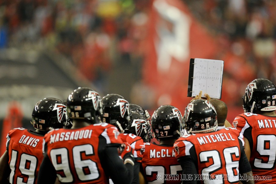Falcons' defense huddles.