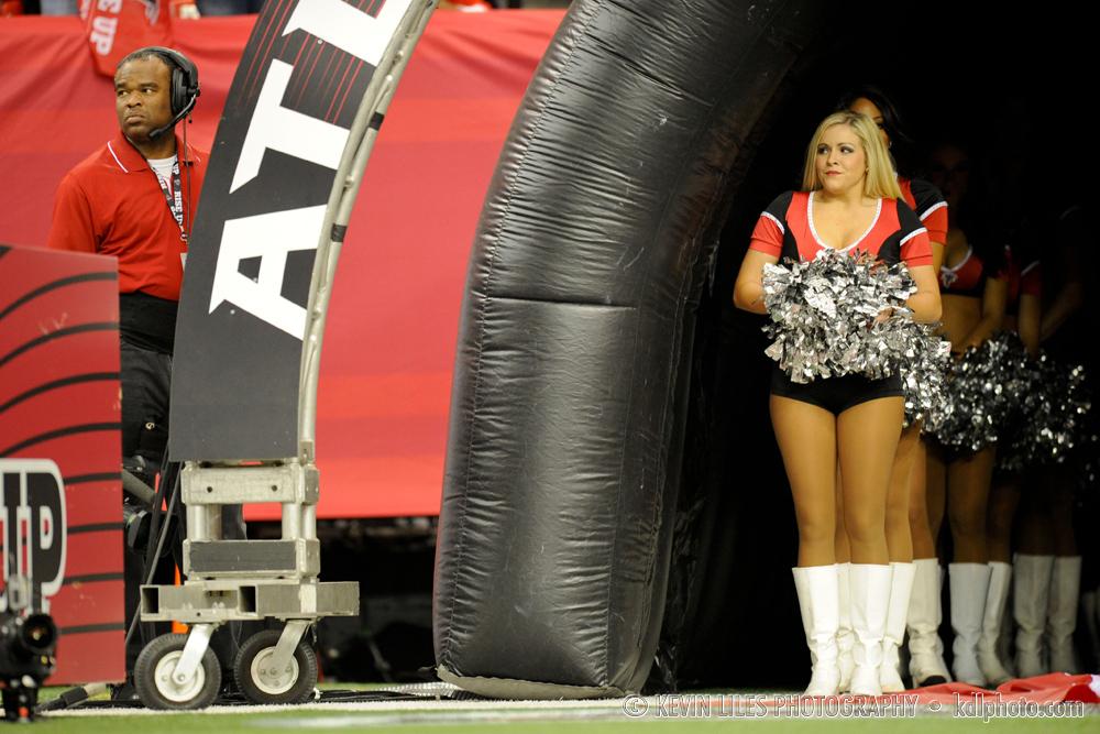Cheerleaders prepare to enter the field during pre-game festivities
