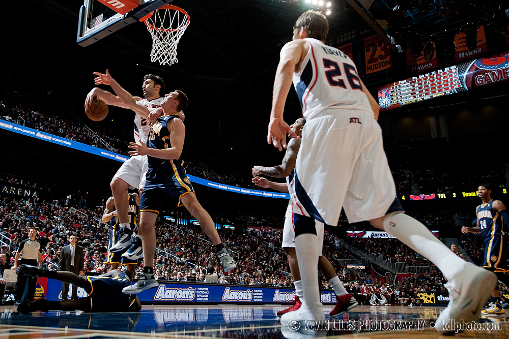 Atlanta Hawks center Zaza Pachulia (27) blocks a shot by Indian Pacers' Tyler Hansbrough at Philips Arena.