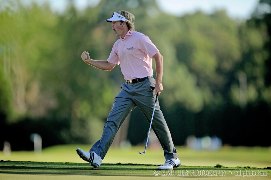 Brandt Snedeker (USA) celebrates after chipping in for birdie on the 17th hole during the final round of the TOUR Championship at East Lake Golf Club.