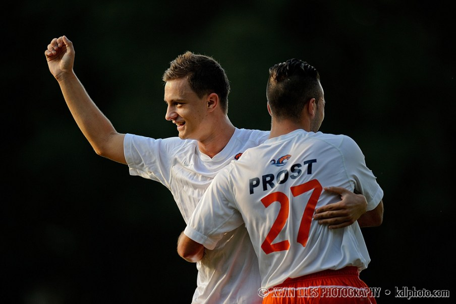 Clayton State University midfielder Elliott Prost and Ado Junuzovic celebrate a goal.