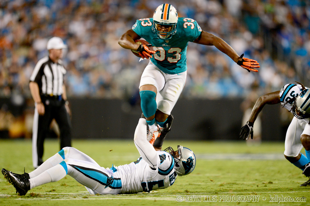 Miami Dolphins running back Daniel Thomas carries the ball against the Carolina Panthers at Bank of America Stadium.