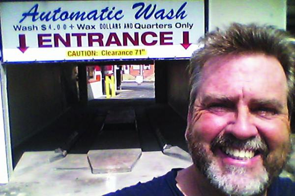 Owner and Car Wash Entrance